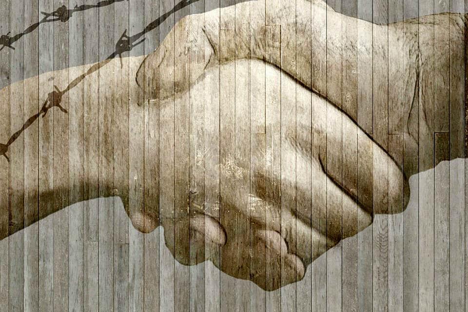 handshake barbed wire
